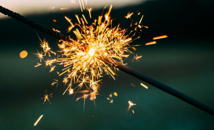 Two sparklers, one lighting the other. Keywords: Investments, UC Invest, ASIC, AFSL