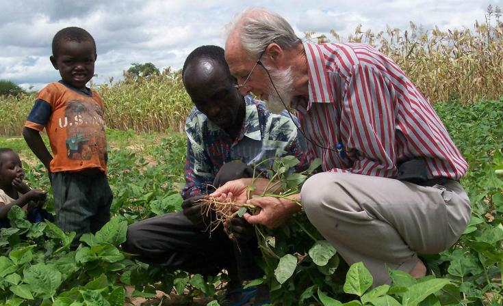 Rev Brian Polkinghorne shares his farming and environmental experience with a farmer and his family in Tanzania.
